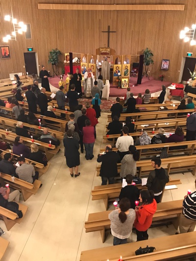 Congregation re-enters the brightly lit Church on Pascha
