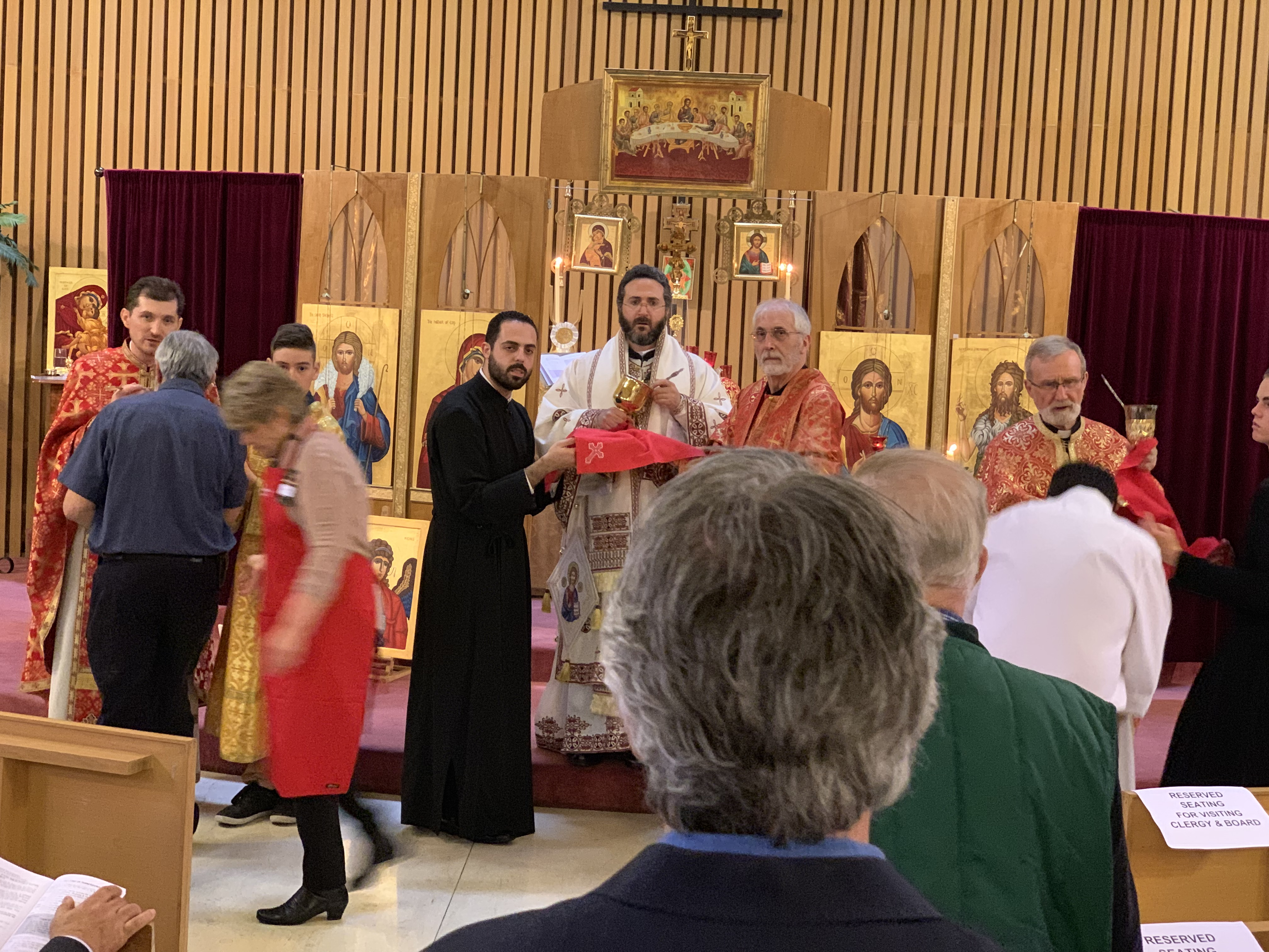 Communion served by Metropolitan Basilios at The Good Shepherd