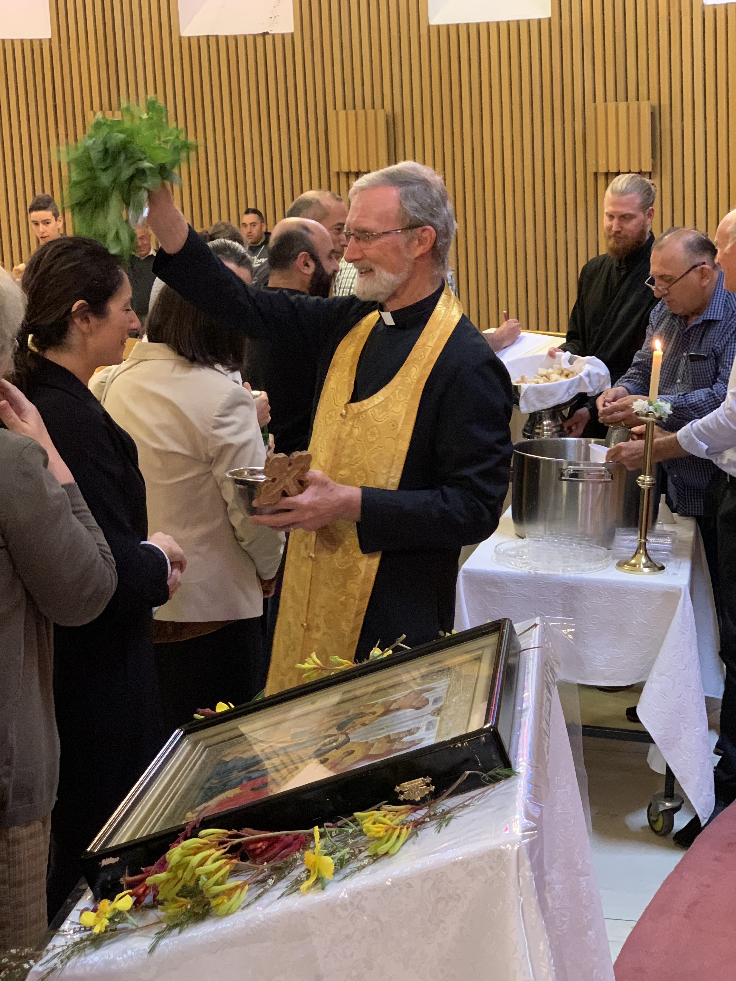 Fr Geoff blessing parishioners