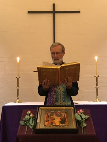 Fr. Geoff reads the Gospel during the Akathist