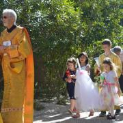 Children march in the Triumphal Entry
