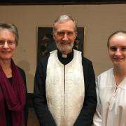 Fr. Geoff with the baptismal candidate and her god-mother