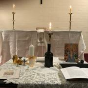 The table of preparation (foreground) and the altar (background) in the small chapel