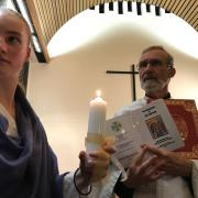 Fr. Geoff and the baptismal candidate