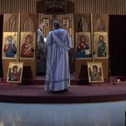 Deacon Nicholas stands before the iconostasis.