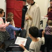 Fr. Geoff blessing a child.